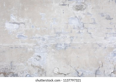 Damaged grey concrete wall exterior background texture