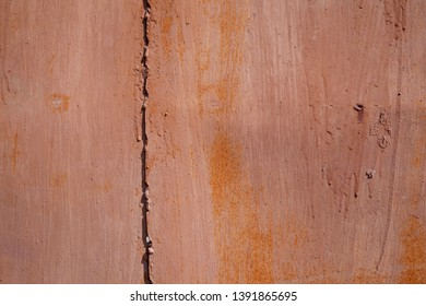 Damaged grunge metal wall background of red brown painted garage. Copy space