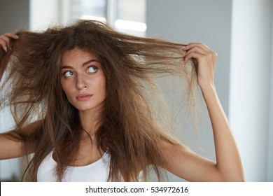 Dry Damaged Hair Stock Images, Royalty-Free Images & Vectors ...