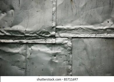 damaged iron  tin, welded joint, grunge metal background