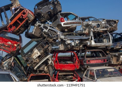 Damaged old cars on junkyard are waiting for recycling