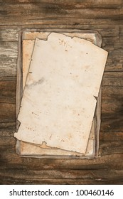 Damaged old papers on a wooden background