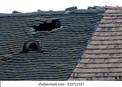 Damaged old tiled roof broken leaked
