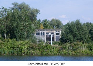 damaged old warehouse on the shore of a lake