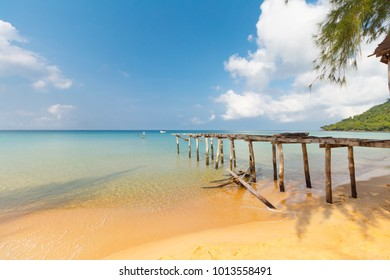 damaged pier at sunset beach on Koh Rong Sanloem, Cambodia, turquiose water, paradise