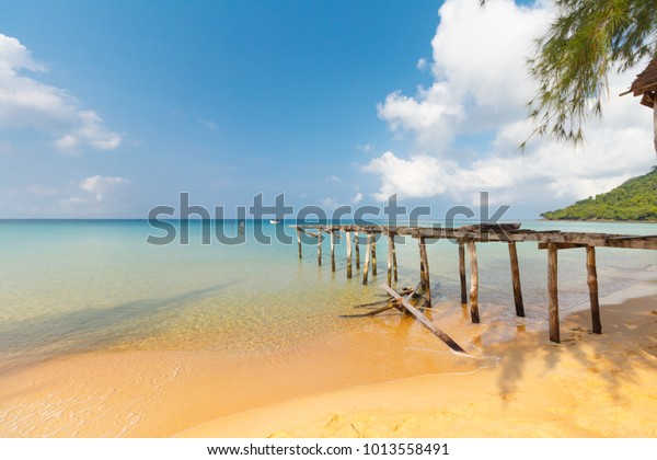 damaged pier at sunset beach on Koh Rong Sanloem, Cambodia, turquiose water, paradise