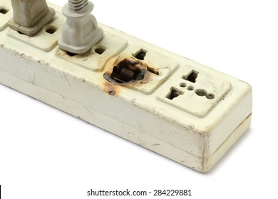 Damaged power strip isolated on white background