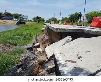 Damaged road construction,Road collapses with huge cracks. International road collapsed down after bad construction. Damaged Highway Road. Asphalt road collapsed and fallen.