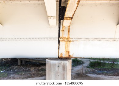 Damaged and rusted metal bridge construction with rust and corrosion on connected part with bolts danger for use in transportation