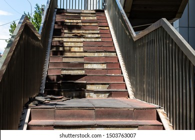 Damaged staircase. Old staircase in the metropolis. Broken stairs on a flight of stairs