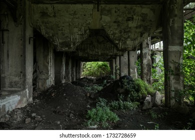 A damaged structure of an abandoned building full of dirt
