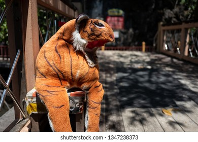 A damaged stuffed animal tiger in Langkawi, Malaysia.