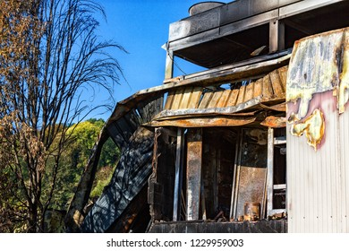 Damaged supermarket boiler room with ventilation, turbine, after arson fire with burn black dark debris intense burning fire disaster ruins waiting for investigation for insurance. Dramatic