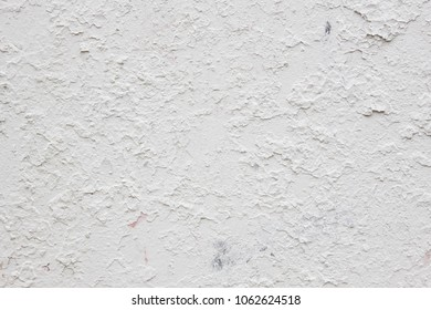Damaged textured white wall. Cracked material. Construction. Horizontal