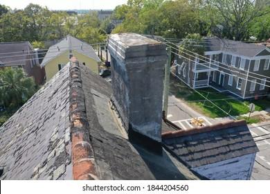 Damaged tile roof that needs repairs in Charleston, South Carolina