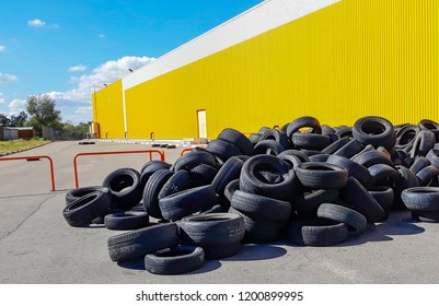 Damaged tires after high speed driving. Pile of used old damaged tires. Charred damaged tires after driving in drift.
