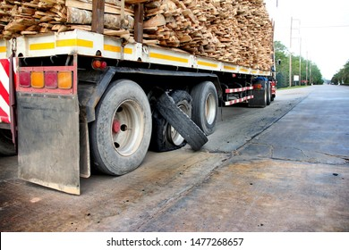 Damaged truck tires.damaged 18 wheeler semi truck burst tires by highway street.damaged tire after tire explosion at high speed on highway.