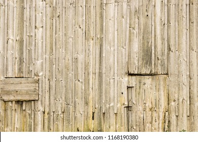 Damaged and weathered old wood barn boards, for background texture