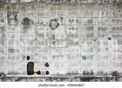 damaged white brick wall