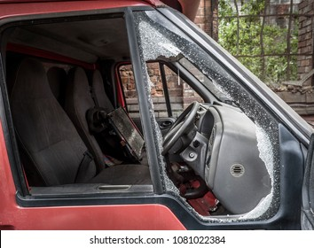 Damaged window pane of a van cracked by theft.
