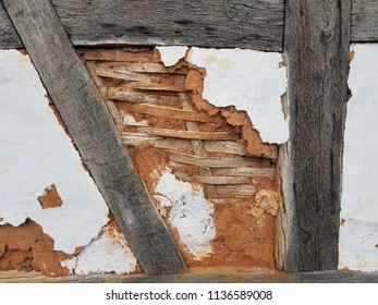 damaged wood and plaster wall