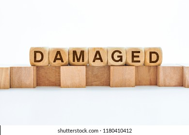 Damaged word on wooden cubes