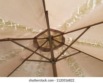 damaged and worn umbrella for a table