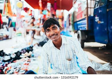 DAMAN MARKET PLACE, INDIA - November 28, 2017: Smiling man at Daman Market place.