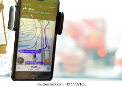 Damansara, Malaysia. 21 April 2019. Man using Waze on mobile app to view mapping. Waze is most popular mobile app for Malaysian user for navigating.