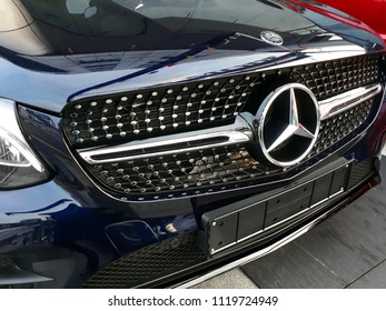 Damansara, Malaysia - June 22, 2018 :  Mercedes Benz motor company logo on the front of a car. Mercedes-Benz is a German automobile manufacturer.