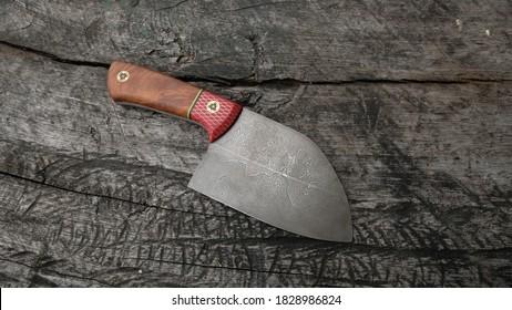 Damascus Knife on wood background