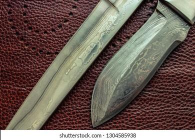 Damascus steel blade of knife. closeup of wootz, blacksmith forging process.