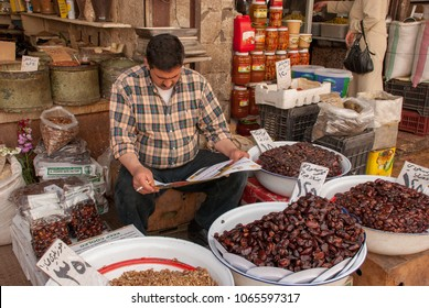 Damascus / Syria - April 5, 2009 : Local street vendor selling dried fruit in the local market of Damascus
