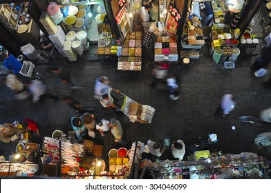 DAMASCUS, SYRIA - AUGUST 11, 2009: Market day at Al-Hamidiyah Souq. Shoppers of Damascus go here for ordinary purchases: fruits, spices, nuts, olives. This is the largest and oldest souk in Syria.
