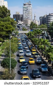 Damascus, Syria, CIRCA September 2013. Traffic on the street in Damascus.