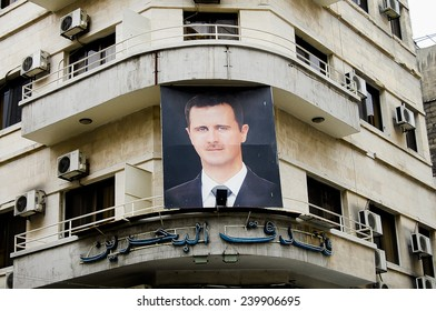 DAMASCUS, SYRIA  - JANUARY 14, 2010:  Photo of president Bashar al-Assad on a building in the capital city before the outbreak of the civil war