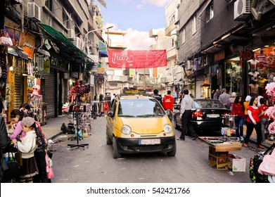 DAMASCUS, SYRIA - NOVEMBER 16, 2012: Daily life at the streets of Damascus Sham before war. Damascus was conquered by Alexander the Great. After the death of Alexander in 323 BC.