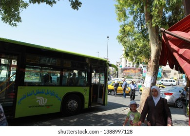 DAMASCUS, SYRIA- In the second year of the Syrian war, the people carrying buses in the capital Damascus and people on the street. The photo was taken, July 18, 2012