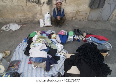 Damascus, Syria-October 1, 2009: A man sells clothes on the street in Damascus