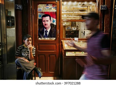 Damascus,Syria - August 04,2010 : Pre-war Syria.A poster of Syrian president Bashar al-Assad hangs in front of a shop in the old city of Damascus.