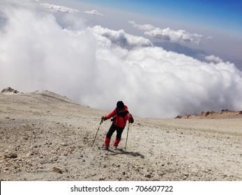 DAMAVAND MOUNTAIN, IRAN - October, 2016: Climber reaching the summit of Damavand mountain, 5671 m, Iran on October, 2016