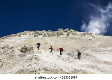DAMAVAND MOUNTAIN, IRAN - October 5, 2016: Climbers reaching the summit of Damavand mountain, 5671 m, Iran on October 5, 2016