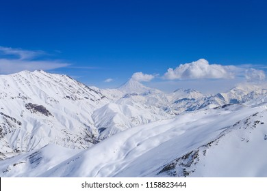 Damavand view from dizin ski resort top point on a sunny winter day. beautiful weather for ski.