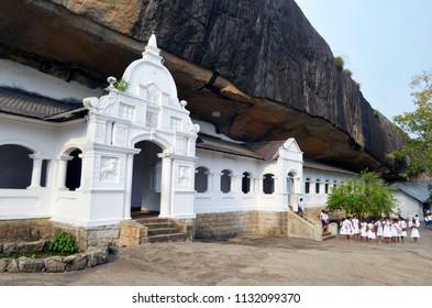 Dambulla, Sri Lanka - April 2, 2018: The outdoor gallery in the Golden Temple of Dambulla, or Dambula Cave Temple, or Rangiri Dambulla Raja Maha Viharaya, a UNESCO World Heritage Site.