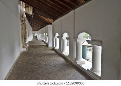 Dambulla, Sri Lanka - April 2, 2018: The outdoor gallery in the Golden Temple of Dambulla, or Dambula Cave Temple or Rangiri Dambulla Raja Maha Viharaya, a UNESCO World Heritage Site.