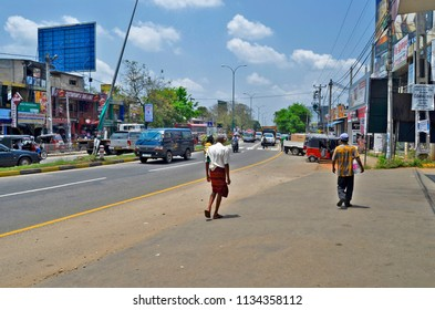 Dambulla, Sri Lanka - April 2, 2018: Downtown Dambulla almost only consists of this main road that splits into two roads at the Clock Tower, South of the city.