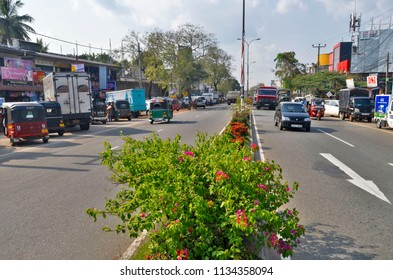 Dambulla, Sri Lanka - April 3, 2018: Downtown Dambulla almost only consists of this main road that splits into two roads at the Clock Tower, South of the city.
