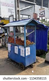 Dambulla, Sri Lanka - April 3, 2018: Take away food booth on the main road of Dambulla.