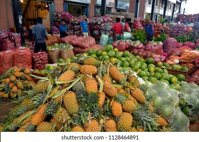 Dambulla, Sri Lanka, April 4, 2018 - The bustling and colorful Dambulla Dedicated Economic Center, a wholesale fruit and vegetable market full of busy merchants and customers.