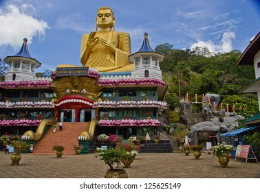 DAMBULLA, SRI LANKA - AUGUST 26: Cave temple on August 26, 2012 in Dambulla, Sri Lanka. Cave temple has five caves under a vast overhanging rock and dates back to the first century BC.